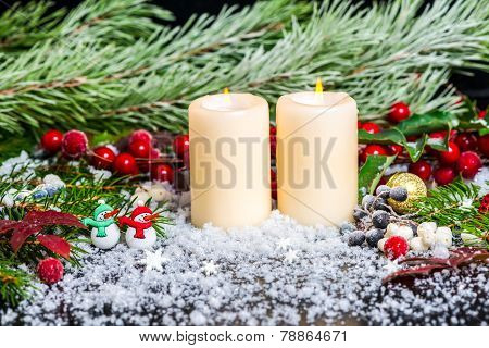 Christmas Concept Of Snowman, Evergreen Branches, Red Leaves, Berry With Snow, Candles And Gold Ball