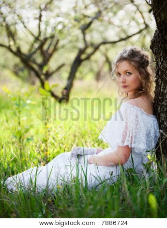 Woman In White Dress Sitting On Grass