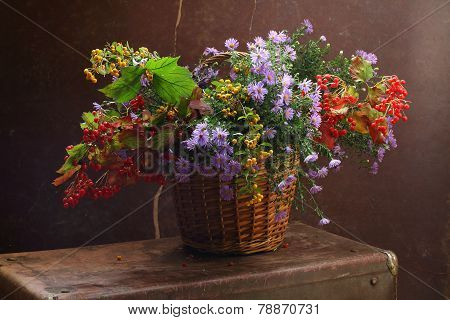Flowers And Guelder-rose Branches In A Wattled Basket