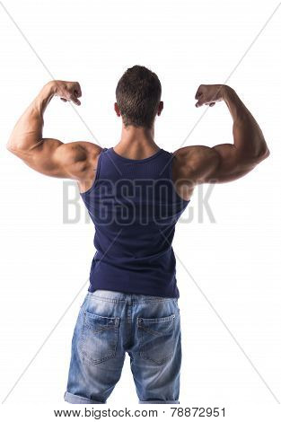 Attractive Muscular Man Striking A Pose, Showing Back And Biceps