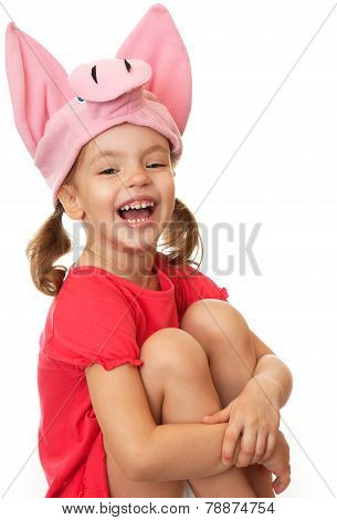 Little girl in hat cheerful pig.