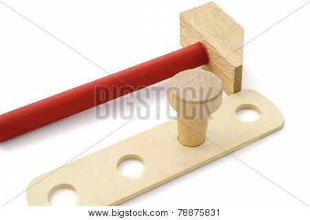 Wooden Hammer And Nail.