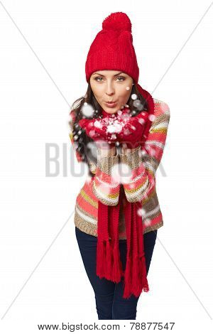 Winter woman blowing snow at you
