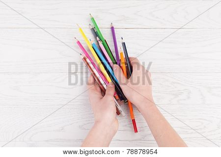 Colour Pencils In Hands