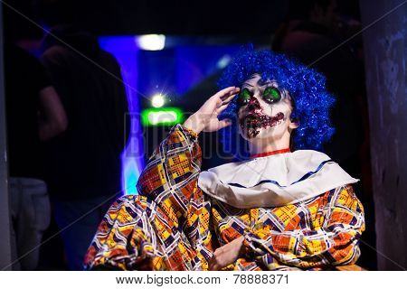 Crazy ugly grunge evil clown in town on Halloween making people shock and scared. Crazy ugly grunge