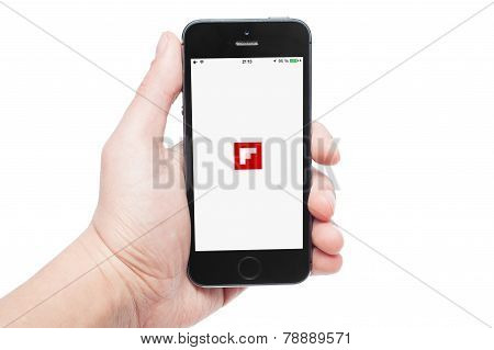 Photo Of A Hand Using Flipboard App On Iphone 5S