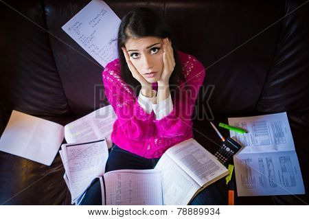 Tired student having a lot to read. Student girl with lot of books around. Student is studying.