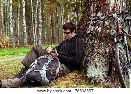 Cyclist man resting in forest