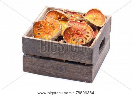 Slices Of Dried Bael Fruit In Wooden Box With Copy Space.