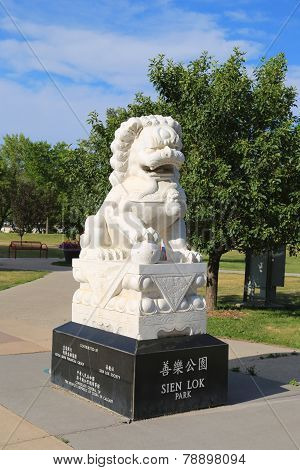 Lion sculpture at the entrance to Sien Lok Park in Calgary