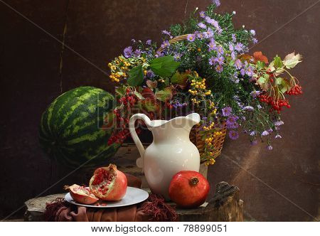 Water-melon, A Pomegranate, A White Jug And A Bouquet In A Wattled Basket
