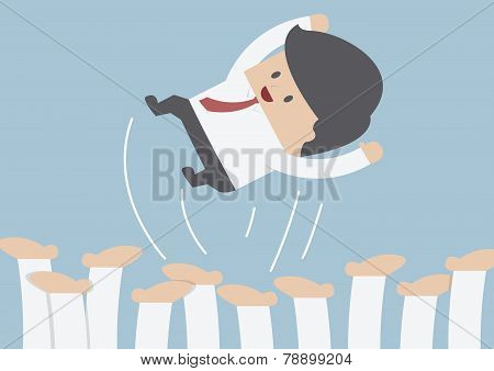 Businessman Being Throwing Up By His Team, Success Concept