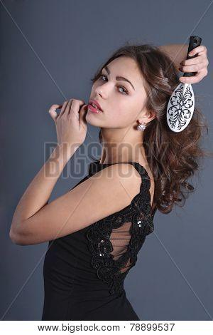 Girl Combing Comb His Wavy Hair
