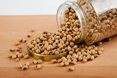 foto of soybeans  - Close up of soybean in a jar with lid off on wood table - JPG