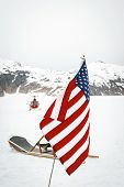 stock photo of sled  - Helipcopter Drops Off Tourists At A Dog Sled Camp At Alaska - JPG