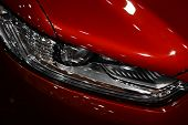 pic of headlight  - Detail on one of the LED headlights of a car - JPG
