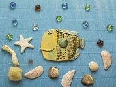 picture of shell-fishes  - collage ceramic fish under water with shells and a reflection of the stars - JPG