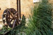 stock photo of water-mill  - Wooden wheel of an old water mill  - JPG
