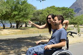 picture of wheelchair  - Disabled man in wheelchair and girlfriend in the park - JPG
