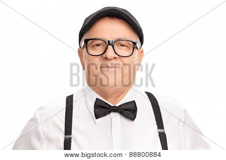 Portrait of a stylish senior with a beret and a bow-tie, smiling and looking at the camera isolated on white background