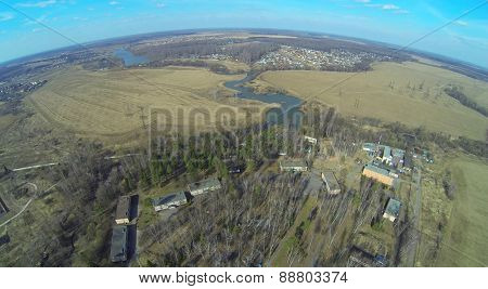 Landscape with health camp for children and field in the spring day, aerial view