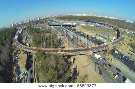 Round overpass on the highway during construction, aerial view
