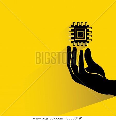 hand holding a microchip