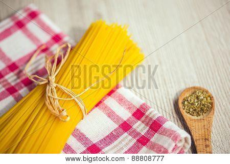 Close up of spaghetti and oregano on kitchen table