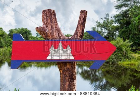 Cambodia wooden sign with forest background