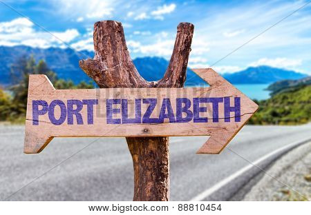 Port Elizabeth wooden sign with road background
