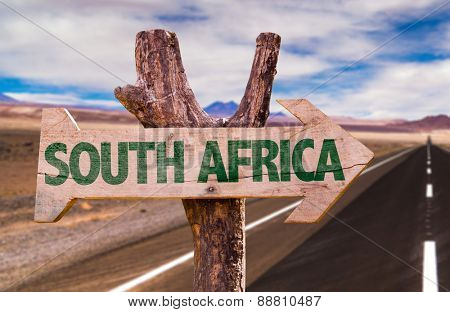 South Africa wooden sign with desertic road background