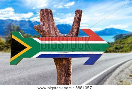 South Africa Flag wooden sign with road background
