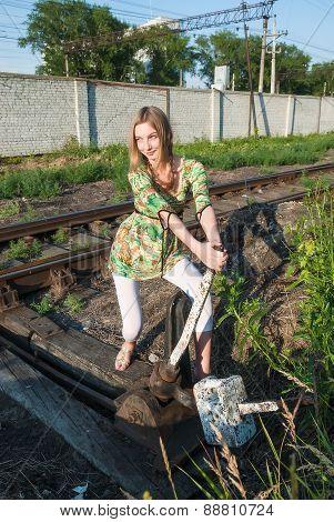 Pretty girl throws railway switch