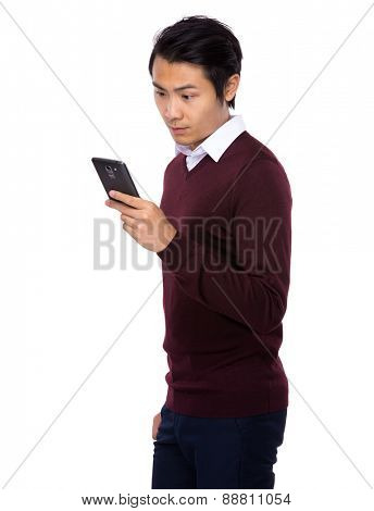 Asian businessman look at smertphone