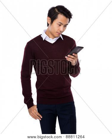 Asian man look at cellphone