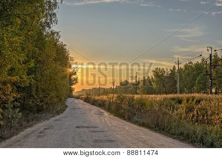 Country Road And Railway On Sunrise