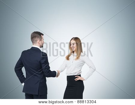 Young Couple At The Business Meeting. Handshake As A Concept Of Successful Deal.