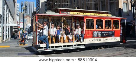 Passengers enjoy a ride in a cable car