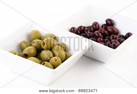 Pickled olives in white bowl