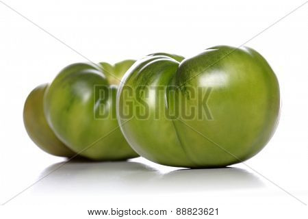 Studio shot of green tomato