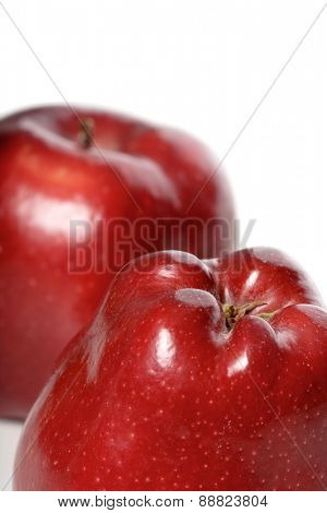 Close-up of red apples on white background