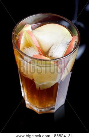 Glass of apple juice on white background