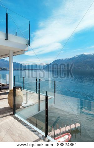 beautiful terrace of a modern penthouse, lake view