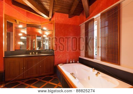 Interior house, comfortable bathroom, red walls