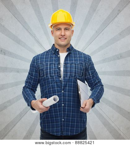 repair, construction, building, people and maintenance concept - smiling male builder or manual worker in helmet with blueprint and clipboard over gray burst rays background