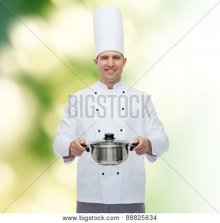 cooking, profession and people concept - happy male chef cook holding pot over green background