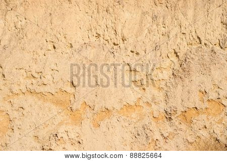 Texture of orange colored underground clay surface