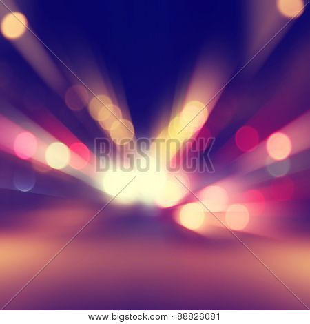 Abstract image of bokeh lights with motion blur in the city.