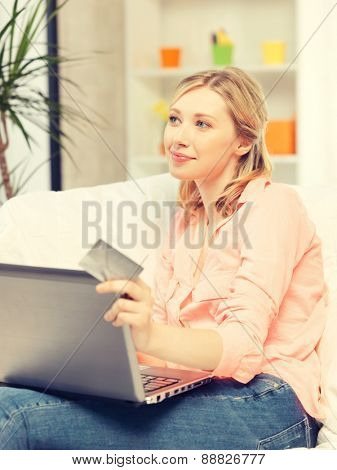 picture of happy woman with laptop computer and credit card..