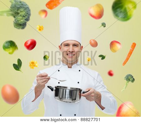 cooking, profession and people concept - happy male chef cook with pot and spoon